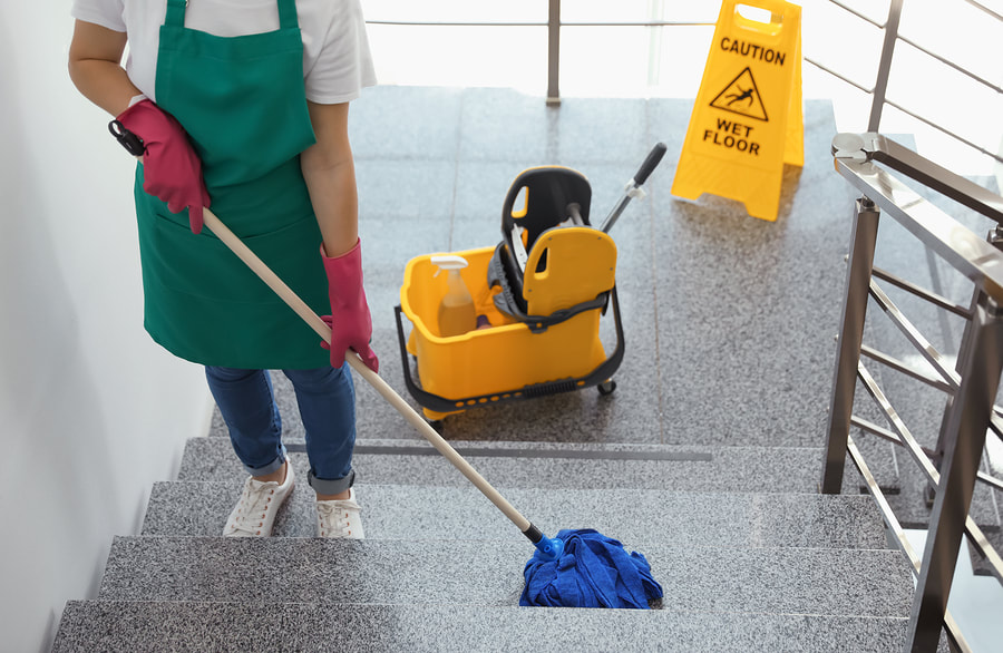 woman mopping the stairs